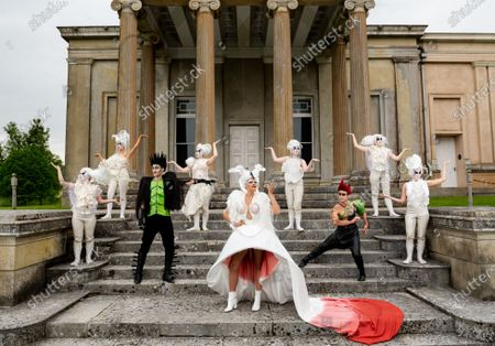 Pictured: The cast of A Midsummer Nightâ€s Dream L/R Anna Munoz, Francesca Pringle, Alexander Chance, Isabel Irvine, Samantha Clarke, May Abercrombie,Chris Darmanin, Daisy Mitchell and Ceferina Penny rehearse on the steps infront of the Orangery, against the dramatic Ionic theatre columns on the southwest corner of The Grange at Northington, a 19th-century country house-mansion in Northington, Hampshire ahead of the start of The Grange Festival.   The Grange Festival, which between June and July hosts opera, theatre and dance amongst the magnificent neoclassical residence which resembles a Greek temple buried in the heart of Hampshire, begins on Thursday 24 June 2021 with Paul Curran's production of A Midsummer Night's Dream.    Auction house Olympia Auctions are hosting three auctions for The Grange Festival, alongside world-famous heritage sites Westminster Abbey and The Wallace Collection in London due to the devastating effects of the coronavirus pandemic. The three auctions are expected to raise over £50,000 in total for the three institutions, with further auctions planned later in the year.