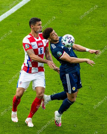 Che Adams controls the ball from Dejan Lovren during the UEFA Euro 2020 Championship Group D match between Croatia and Scotland at Hampden Park, Glasgow.