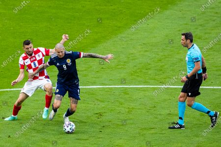 Lyndon Dykes holds off Mateo Kovacic during the UEFA Euro 2020 Championship Group D match between Croatia and Scotland at Hampden Park, Glasgow.