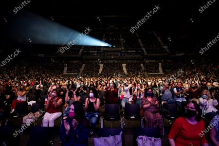 People attend a gig by Spanish singer David Bisbal on occasion of his 'En tus planes 2021' tour kick off concert at Wizink Center in Madrid, Spain, 22 June 2021.