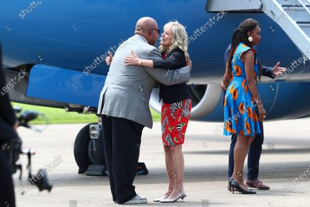 First lady Jill Biden hugs Rep. Bennie Thompson, D-Miss., as she arrives at Jackson-Medgar Wiley Evers International Airport in Pearl, Miss