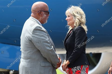 Stock Photo of First lady Jill Biden greets Rep. Bennie Thompson, D-Miss., as she arrives at Jackson-Medgar Wiley Evers International Airport in Pearl, Miss