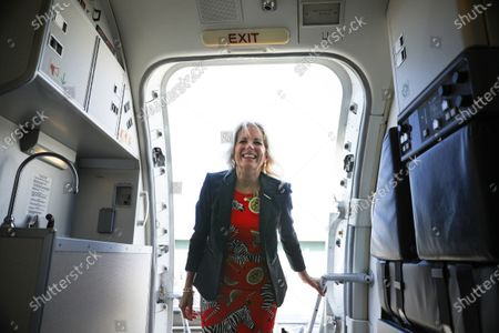 Stock Picture of First lady Jill Biden boards an aircraft at Jackson-Medgar Wiley Evers International Airport, in Pearl, Miss