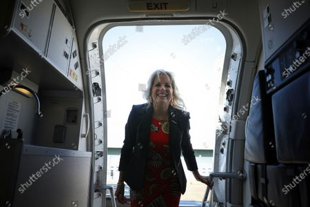 First lady Jill Biden boards an aircraft at Jackson-Medgar Wiley Evers International Airport, in Pearl, Miss
