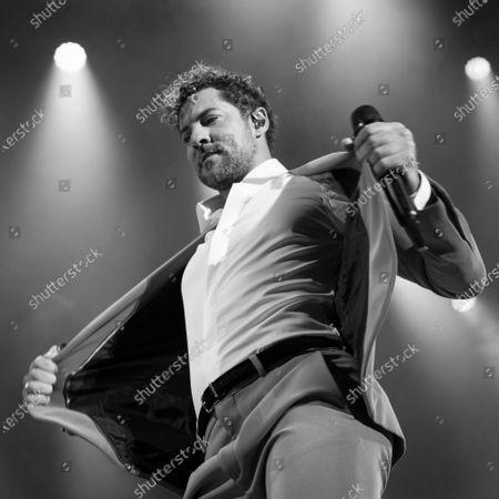 David Bisbal performing at the EN TUS PLANES 2021 tour