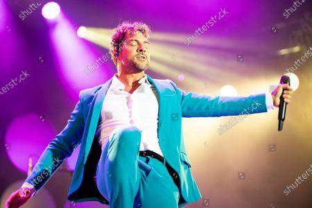 Stock Picture of David Bisbal performing at the EN TUS PLANES 2021 tour
