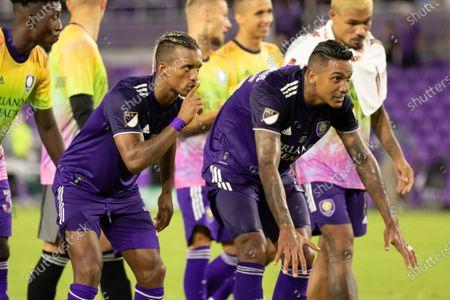 Nani (17 Orlando City) and Antonio Carlos (25 Orlando City) prepare to celebrate with the fans after the Major League Soccer game between Orlando City and San Jose Earthquakes at Exploria Stadium in Orlando, Florida.
