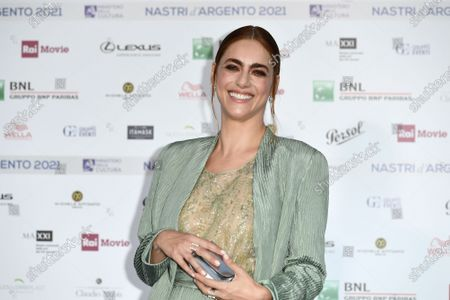 Stock Picture of Miriam Leone on Blue carpet for the 'Nastri d'Argento' Award (Silver Ribbon) 2021 ceremony at the MAXXI - National Museum of 21st Century Art in Rome