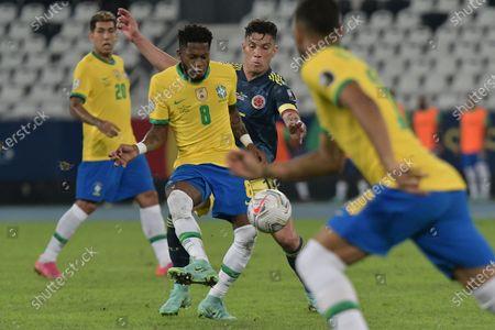 Stock Photo of Fred of Brazil and Mateus Uribe of Colombia; Nilton Santos Stadium, Rio de Janeiro, Brazil; Copa America, Brazil versus Colombia.