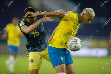 Richarlison of Brazil holds off Mateus Uribe of Colombia; Nilton Santos Stadium, Rio de Janeiro, Brazil; Copa America, Brazil versus Colombia.