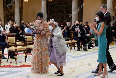 Stock Picture of King Felipe VI (R, back) and Queen Letizia of Spain (R, front) applaud after presenting a Gold Medal of Merit in the Fine Arts to Cuban singer Omara Portuondo (C) during the awarding ceremony held at El Pardo Palace in Madrid, Spain, 23 June 2021. The Gold Medal for Merit in the Fine Arts is awarded by the Spanish ministry of culture to individuals or organizations excelling in artistic and cultural works as well as to those who intervene in the promotion of art and culture and the conservation of the artistic heritage.