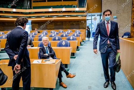 Stock Image of (L-R) Jesse Klaver (Groenlinks), Geert Wilders (PVV) and Wopke Hoekstra (CDA) prior to the debate on the final report of Leader of negotiations Mariette Hamer about government's coalition talks in the House of Representatives in The Hague, The Netherlands, 23 June 2021.