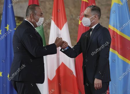 German Foreign Minister Heiko Maas, right, welcomes Turkish Foreign minister Mevlut Cavusoglu for the 'Second Berlin Conference on Libya' at the foreign office in Berlin, Germany