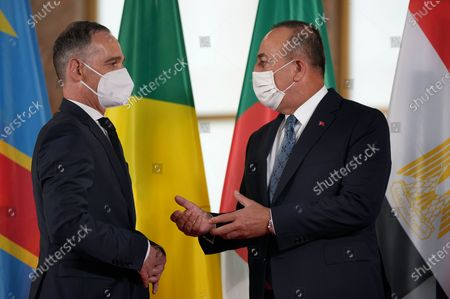 German Foreign Minister Heiko Maas, right, welcomes Turkish Foreign minister Mevlut Cavusoglu, right, for the 'Second Berlin Conference on Libya' at the foreign office in Berlin, Germany