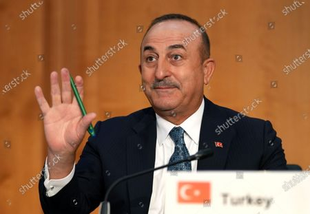 Turkey's Foreign Minister Mevlut Cavusoglu waves during the 'Second Berlin Conference on Libya' at the foreign office in Berlin, Germany