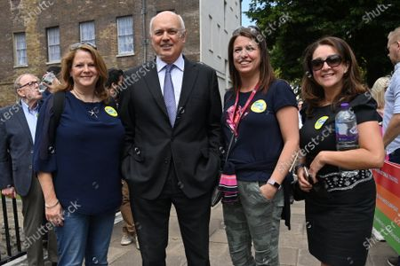 Stock Image of Iain Duncan Smith MP joins protesters representing the UK travel industry take part in a demonstration in Westminster highlighting the situation the current border and travel restrictions due to the Covid 19 pandemic. Industry estimates show more than a third (37 per cent) of the UK's 526,000 travel and tourism jobs could be wiped out due to the pandemic.