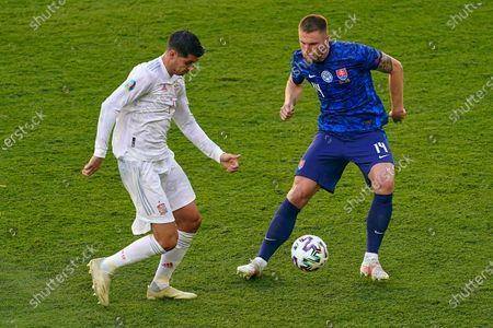 Alvaro Morata of Spain and Milan Skriniar of Slovakia
