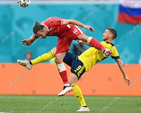 Stock Image of Grzegorz Krychowiak (L) of Poland in action against Marcus Berg of Sweden during the UEFA EURO 2020 group E preliminary round soccer match between Sweden and Poland in St.Petersburg, Russia, 23 June 2021.