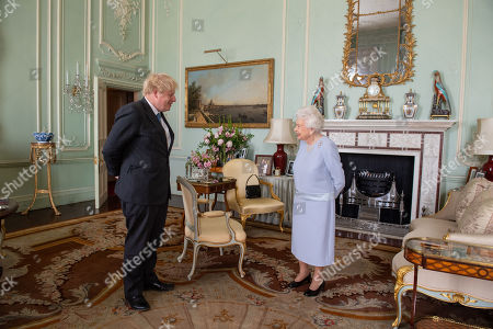 Queen Elizabeth II greets Prime Minister Boris Johnson at an audience at Buckingham Palace, London, the Queen's first in-person weekly audience with the Prime Minister since the start of the coronavirus pandemic.