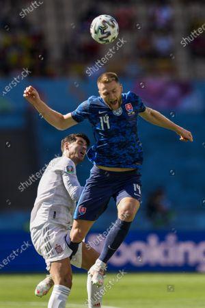 Slovakia's Milan Skriniar, left, jumps for the ball next to Spain's Alvaro Morata during the Euro 2020 soccer championship group E match at La Cartuja stadium in Seville, Spain