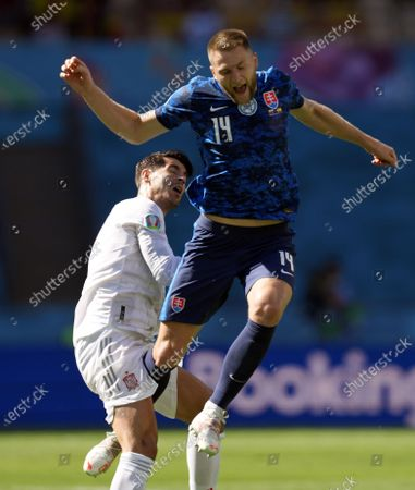 Alvaro Morata (L) of Spain in action against Milan Skriniar of Slovakia during the UEFA EURO 2020 group E preliminary round soccer match between Slovakia and Spain in Seville, Spain, 23 June 2021.