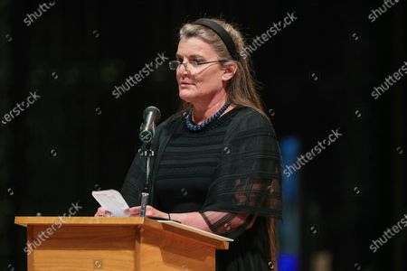 """Virginia Warner reads from """"O Ship of State"""" by Henry Wadsworth Longfellow during the funeral service for former Virginia Sen. John Warner at the Washington National Cathedral, in Washington"""
