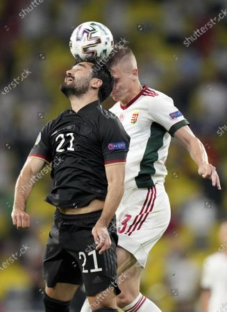 Germany's Ilkay Gundogan, left, and Hungary's Andras Schaefer challenge for the ball during the Euro 2020 soccer championship group F match between Germany and Hungary at the Allianz Arena in Munich, Germany