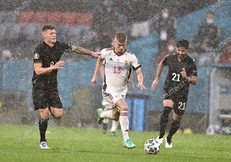 Germany's Toni Kroos, left, Hungary's Andras Schaefer and Germany's Ilkay Gundogan challenge for the ball during the Euro 2020 soccer championship group F match between Germany and Hungary at the Allianz Arena in Munich, Germany