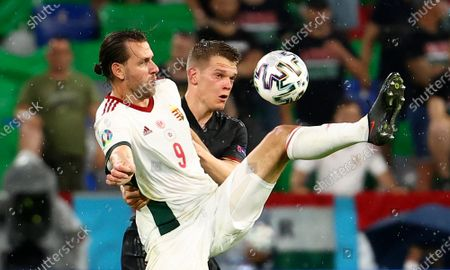 Hungary's Adam Szalai, left, and Germany's Matthias Ginter challenge for the ball during the Euro 2020 soccer championship group F match between Germany and Hungary in Munich