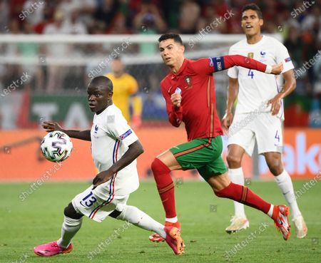 Cristiano Ronaldo (C) of Portugal in action against N'Golo Kante (L) of France during the UEFA EURO 2020 group F preliminary round soccer match between Portugal and France in Budapest, Hungary, 23 June 2021.