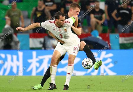 Adam Szalai (L) of Hungary in action against Matthias Ginter of Germany during the UEFA EURO 2020 group F preliminary round soccer match between Germany and Hungary in Munich, Germany, 23 June 2021.