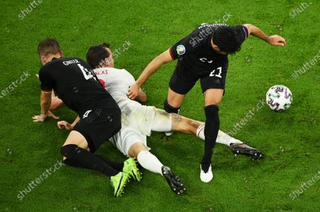 Matthias Ginter (L) and Ilkay Gundogan of Germany in action against Adam Szalai (C) of Hungary during the UEFA EURO 2020 group F preliminary round soccer match between Germany and Hungary in Munich, Germany, 23 June 2021.