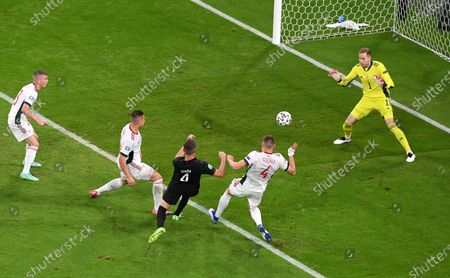 Matthias Ginter (black shirt) of Germany attempts to score during the UEFA EURO 2020 group F preliminary round soccer match between Germany and Hungary in Munich, Germany, 23 June 2021.