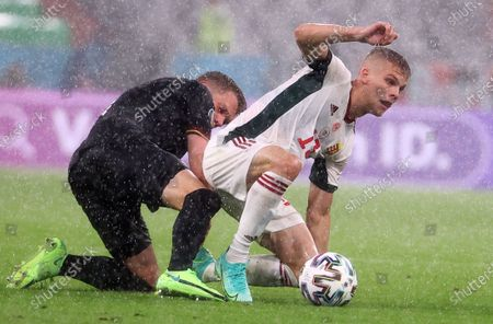 Andras Schafer of Hungary in action against Matthias Ginter (L) of Germany during the UEFA EURO 2020 group F preliminary round soccer match between Germany and Hungary in Munich, Germany, 23 June 2021.