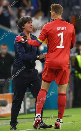 Germany's head coach Joachim Loew and goalkeeper Manuel Neuer (R) of Germany celebrate the 1-1 goal during the UEFA EURO 2020 group F preliminary round soccer match between Germany and Hungary in Munich, Germany, 23 June 2021.