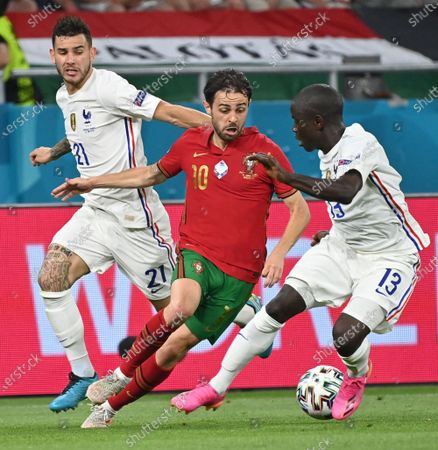 Bernardo Silva of Portugal (C) in action against N'Golo Kante (R) and Lucas Hernandez of France during the UEFA EURO 2020 group F preliminary round soccer match between Portugal and France in Budapest, Hungary, 23 June 2021.