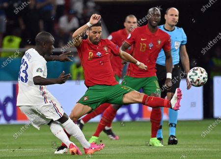 Joao Moutinho of Portugal (C) in action against N'Golo Kante of France (L) during the UEFA EURO 2020 group F preliminary round soccer match between Portugal and France in Budapest, Hungary, 23 June 2021.