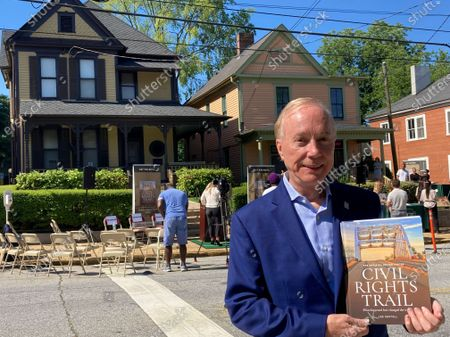 """Stock Image of Lee Sentell, author of """"The Official United States Civil Rights Trail"""" companion book, poses with the book outside the birth home of the Rev. Martin Luther King Jr. in Atlanta on . The U.S. Civil Rights Trail includes more than 120 sites - churches, schools, courthouses, museums - across 15 states, mostly in the South. The new companion book includes more than 200 images of those landmarks today, as well as photographs from the civil rights era"""