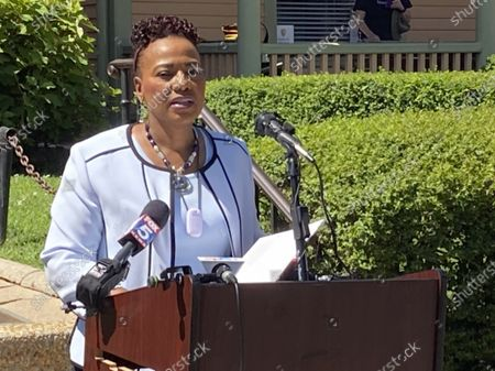 """Stock Photo of The Rev. Bernice King, daughter of the Rev. Martin Luther King Jr. and CEO of The King Center in Atlanta, speaks in front of her father's birth home, at an event launching """"The Official United States Civil Rights Trail"""" companion book. The U.S. Civil Rights Trail includes more than 120 sites - churches, schools, courthouses, museums - across 15 states, mostly in the South. The new companion book includes more than 200 images of those landmarks today, as well as photographs from the civil rights era"""