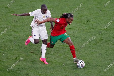 Portugal's Renato Sanches, right, dribbles ahead of France's N'Golo Kante during the Euro 2020 soccer championship group F match between Portugal and France at the Ferenc Puskas stadium in Budapest, Hungary
