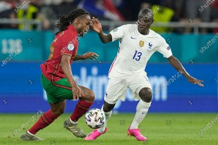 N'Golo Kante (R) of France in action against Renato Sanches of Portugal during the UEFA EURO 2020 group F UEFA EURO 2020 group F preliminary round soccer match between Portugal and France in Budapest, Hungary, 24 June 2021.