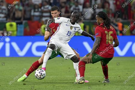 N'Golo Kante (C) of France is challenged by Ruben Dias (L) and Renato Sanches of Portugal for the ball during the Portugal vs. France match in the third round of Group F of the Euro 2020 soccer tournament in Puskas Ferenc Arena in Budapest, Hungary, 23 June 2021.