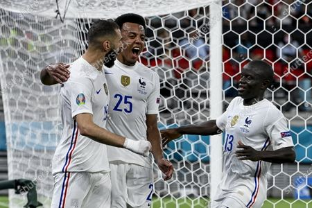 Karim Benzema (L) of France celebrates with Jules Kounde (C) and N'Golo Kante after he scored his side's first goal as goalie Rui Patrício (R) of Portugal looks on during the Portugal vs. France match in the third round of Group F of the Euro 2020 soccer tournament in Puskas Ferenc Arena in Budapest, Hungary, 23 June 2021.