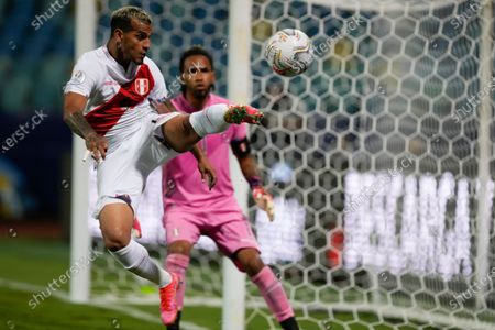 Peru's Miguel Trauco kicks a ball during a Copa America soccer match against Ecuador at Olimpico stadium in Goiania, Brazil