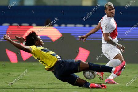 Ecuador's Angelo Preciado, left, and Peru's Miguel Trauco battle for the ball during a Copa America soccer match at Olimpico stadium in Goiania, Brazil
