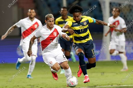 Peru's Miguel Trauco, left, and Ecuador's Angelo Preciado battle for the ball during a Copa America soccer match at Olimpico stadium in Goiania, Brazil