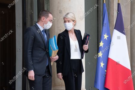 French Junior Minister of Public Action and Accounts Olivier Dussopt (L) and French Junior Minister for Biodiversity Berangere Abba speak after taking part in the weekly cabinet meeting at The Elysee Presidential Palace