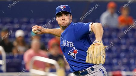 Toronto Blue Jays starting pitcher Ross Stripling throws to first base after catching a hit during the first inning of a baseball game against the Miami Marlins, in Miami
