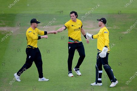 Glenn Phillips, Daniel Worrall and James Bracey of  Gloucestershire celebrate the wicket of D'Arcy Short during the Vitality T20 Blast match between Hampshire Hawks and Gloucestershire at The Ageas Bowl, Southampton