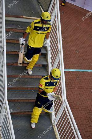 D'Arcy Short and James Vince of Hampshire Hawks walk down the steps  to open the batting during the Vitality T20 Blast match between Gloucestershire and Hampshire Hawks at The Bristol County Ground, Bristol